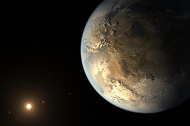 This artist concept depicts Kepler-186f, the first validated Earth-size planet to orbit a distant star in the habitable zone, a range of distance from a star where liquid water might pool on the planet surface.