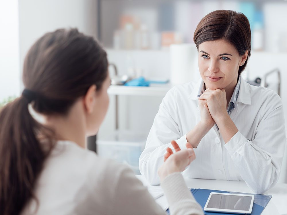 Doctor speaking to female patient