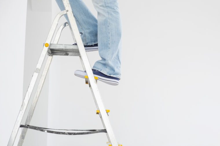 Man on small ladder
