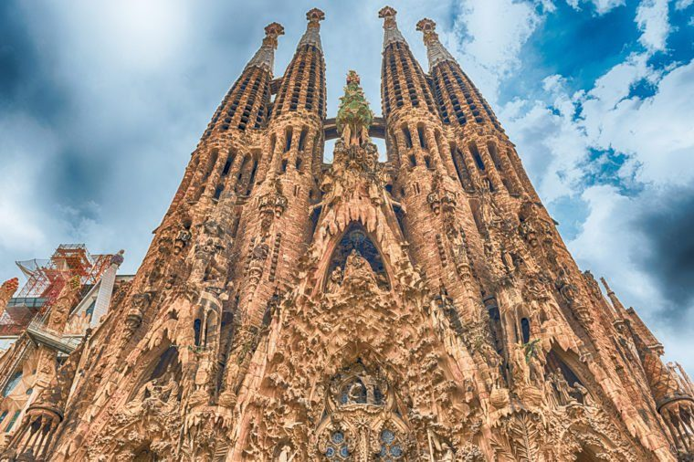BARCELONA - AUGUST 9: The Nativity Facade of the Sagrada Familia, the most iconic landmark designed by Antoni Gaudi in Barcelona, Catalonia, Spain, as seen on August 9, 2017. Cranes digitally removed