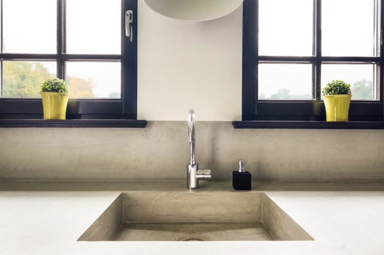 Eindhoven, The Netherlands - December 19, 2015: Contemporary kitchen sink made of natural materials