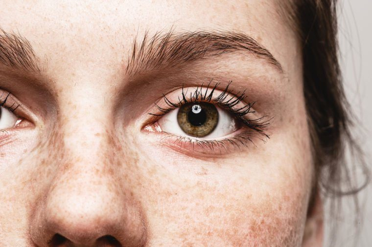 Eyes nose woman Young beautiful freckles woman face portrait with healthy skin