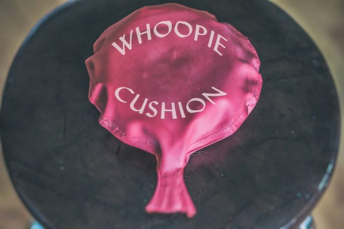 Whoopie Cushion. Whoopie cushion on a chair with the words whoopie cushion printed on it.