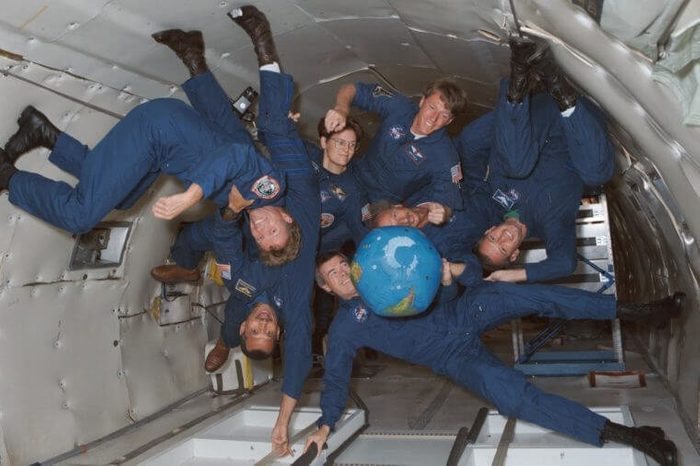 The crew of STS-45 is already training for its March 1992 mission, including stints on the KC-135 zero-gravity-simulating aircraft. Shown with an inflatable globe are, clockwise from the top, C. Michael Foale, mission specialist; Dirk Frimout, payload specialist; Brian Duffy, pilot; Charles R. (Rick) Chappell, backup payload specialist; Charles F. Bolden, mission commander; Byron K. Lichtenberg, payload specialist; and Kathryn D. Sullivan, payload commander.