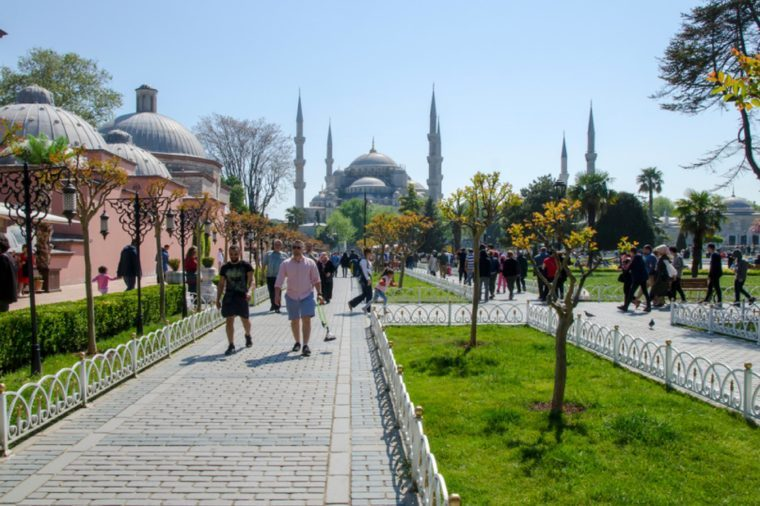 ISTANBUL, TURKEY - APRIL 30: Tourist walking near Blue mosque and Sultanahmet park on April 30th, 2018 Istanbul, Turkey. The biggest mosque in Istanbul of Sultan Ahmed (Ottoman Empire).
