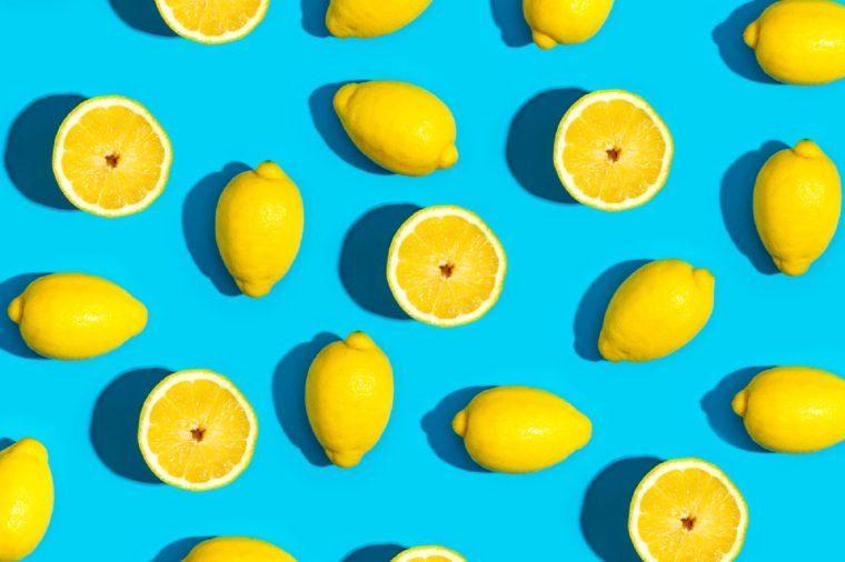 Fresh lemon pattern on a vivid blue background flat lay