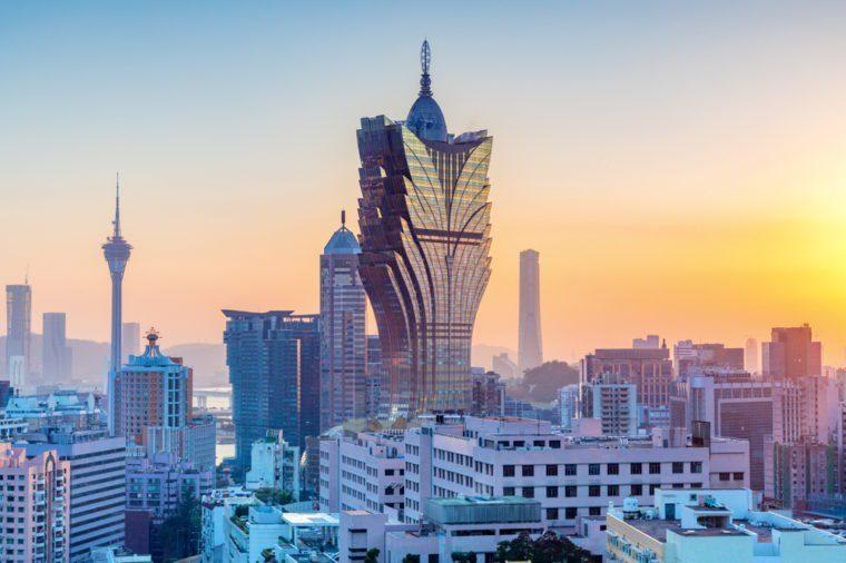 Macau, city skyline at sunset.