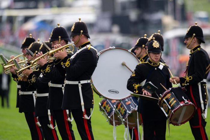 The band of The Royal Logistics Corps playing on the track at the arrival of HM The Queen