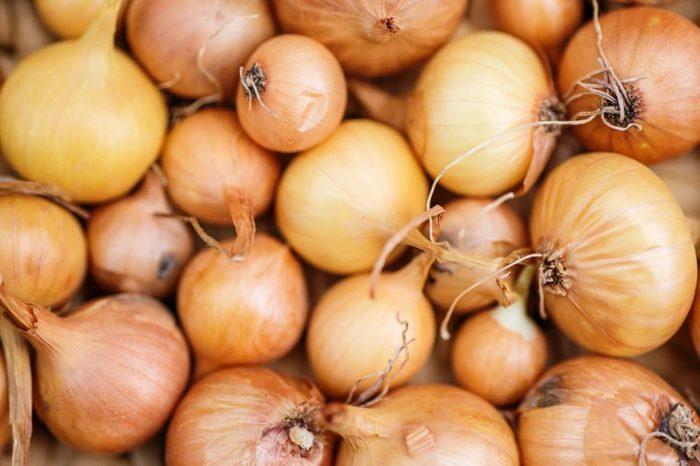 Fresh onions. Onions background. Ripe onions. Onions in market