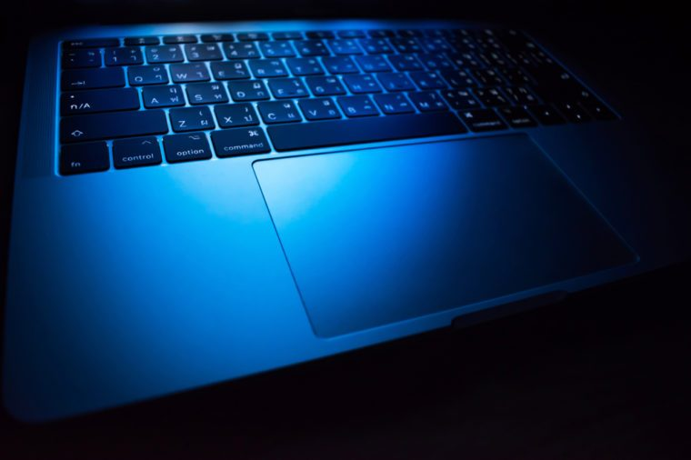 Macbook laptop under blue light