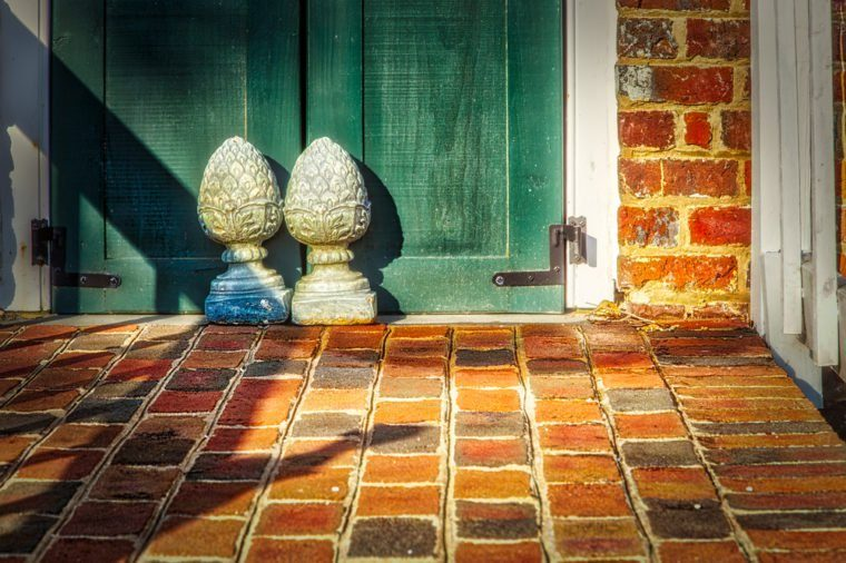 The sun rises on a pair of doors stops on the front patio of the Ferry Plantation House in Virginia Beach, VA.https://en.wikipedia.org/wiki/Ferry_Plantation_House