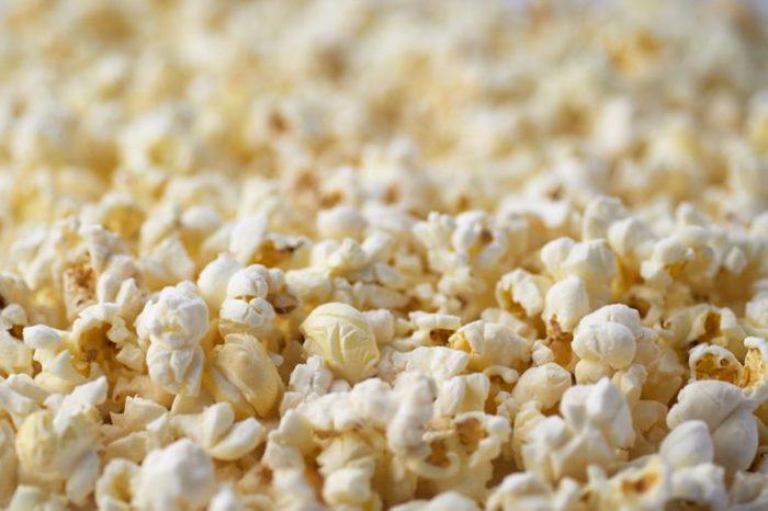 Popcorn Texture Background. Salted Popcorn Grains. Text Space