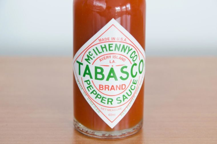 Pruszcz Gdanski, Poland - April 7, 2018: Close-up for Tabasco logo on bottle. Tabasco sauce is hot sauce made from tabasco peppers, vinegar and salt.