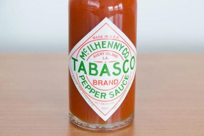 Pruszcz Gdanski, Poland - April 7, 2018: Close-up for Tabasco logo on bottle. Tabasco sauce is hot sauce made from tabasco peppers, vinegar and salt.