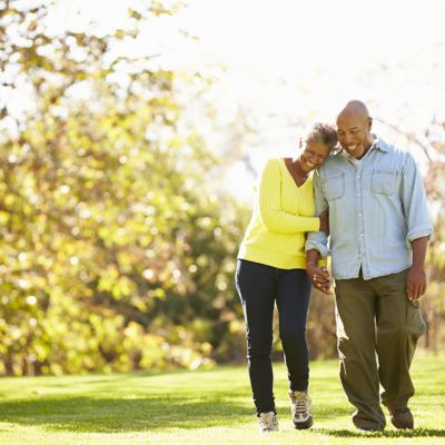 Elderly husband and wife walking in the park