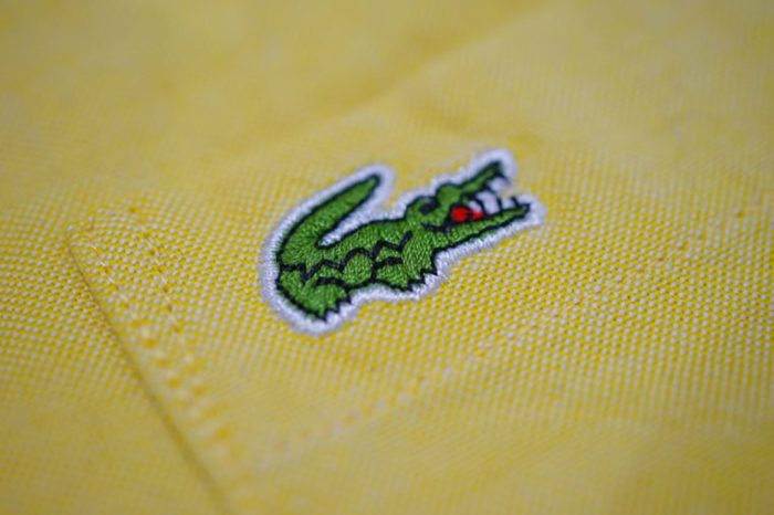 WOODBURY, NEW YORK -1 FEB 2018- View of colorful Lacoste polo shirts on store shelves. Lacoste is a French clothing company famous for its tennis shirts.
