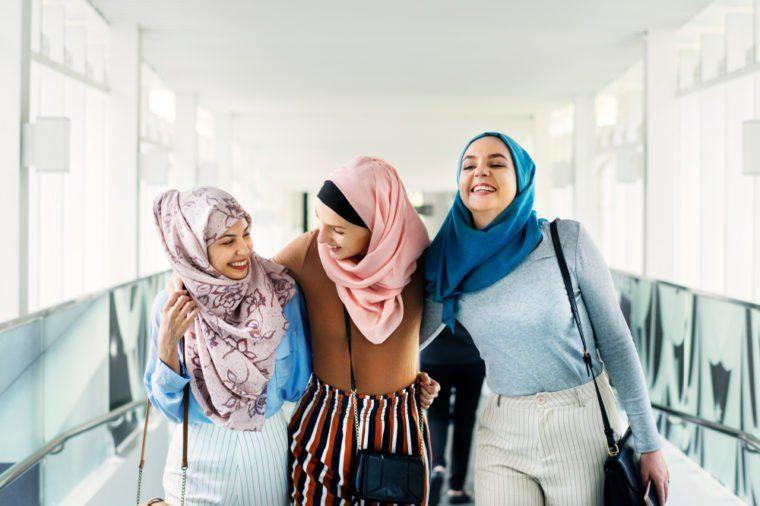 Muslim women talking with friends