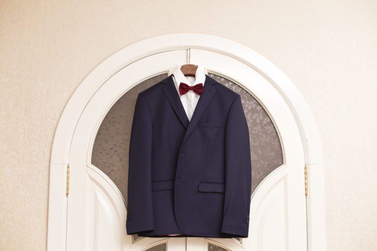 men's suit hanging on trempel. Groom's suit