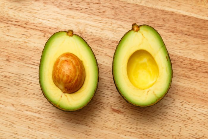 fresh avocados on wooden table.