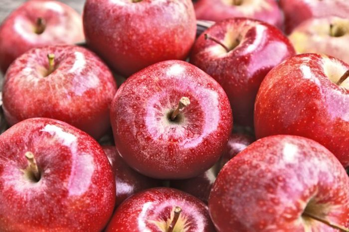 A lot of fresh Royal Red Gala apples in supermarket with full frame.
