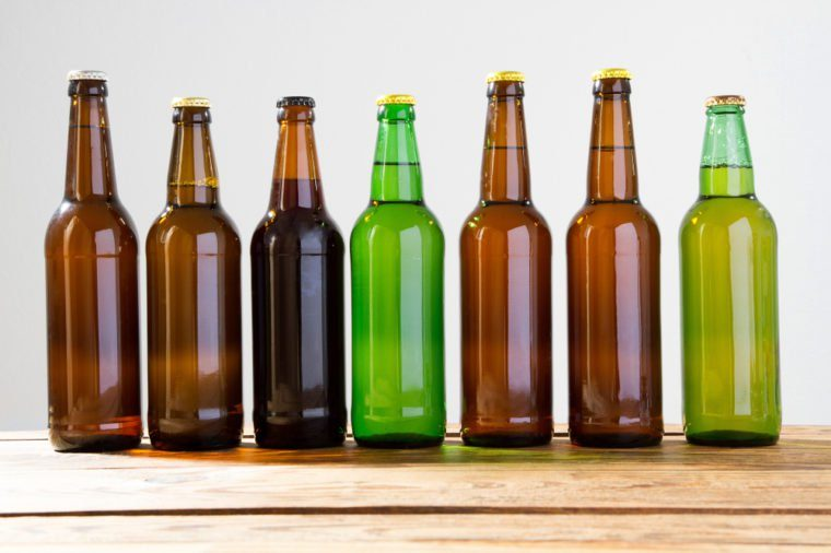 Beer bottles on a wooden table . Top view. Selective focus. Mock up. Copy space.Template. Blank.
