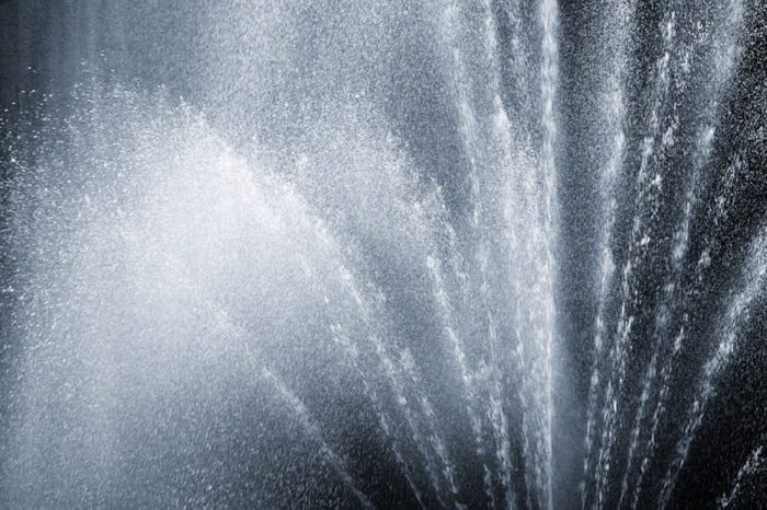 fragment of fountain water drops in the air