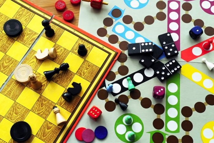 Board games are carelessly strewn across the table.