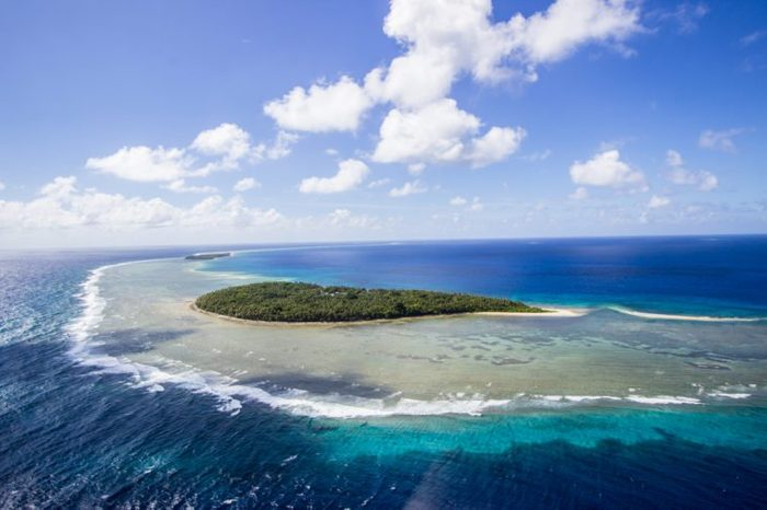 tropical beach scene from micronesia yap state ulithi atoll coral isolated island chain in the south pacific known for natural beauty and wildlife postcard tropical beaches and a very vibrant culture