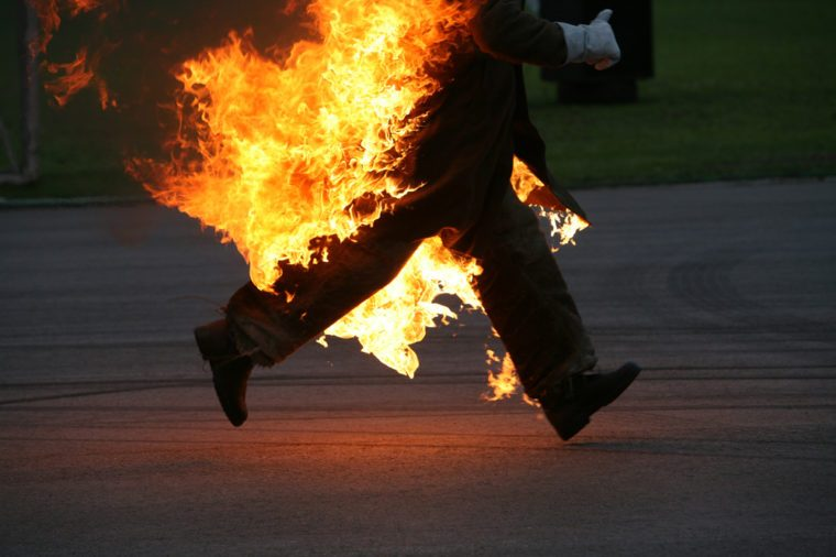 running stunt man on fire