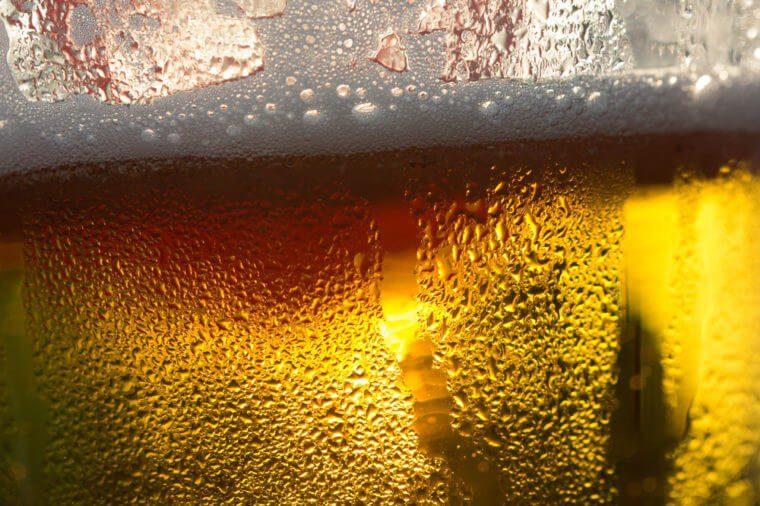 beer close-up, backlit by golden Sun