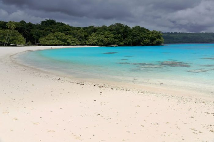 On the white sands and blue-green waters of Champagne beach in Hog Harbour bay closed on the N.by Elephant island the Americans celebrated the end of W.W.II. Espiritu Santo island-Sanma prov.-Vanuatu.