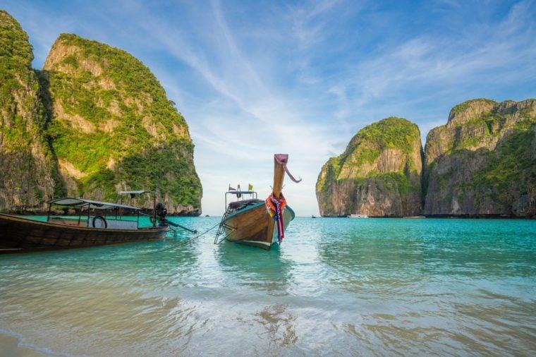 A long tail boat sits in Maya Bay, Koh Phi Phi Ley, Thailand.