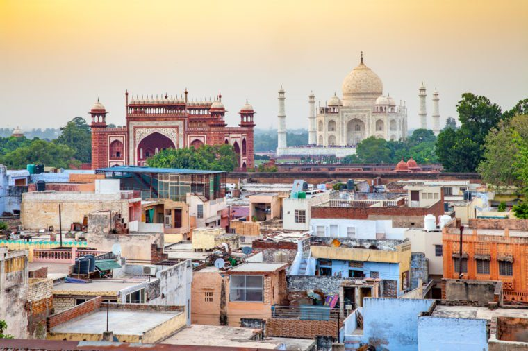 Agra town with Taj Mahal at sunset