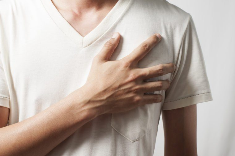 sincere man swearing with hand on heart