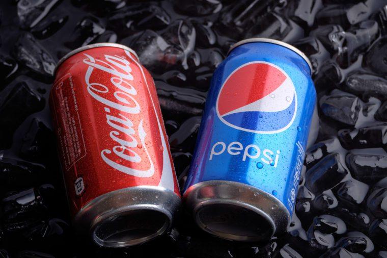 KUALA LUMPUR, MALAYSIA - FEBRUARY 26TH, 2017. Coca-Cola and Pepsi drinks on ice.
