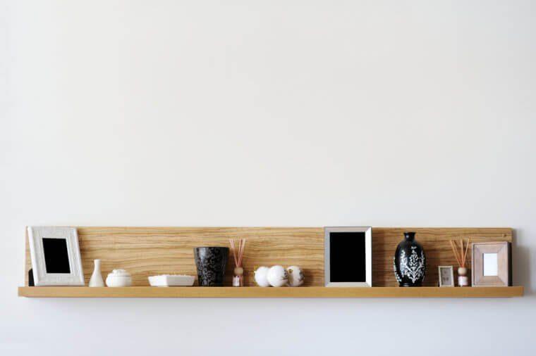 Stylish bookshelf on a white wall