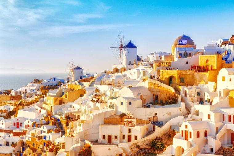 Skyline of Oia, traditional white architecture with windmills, greek village of Santorini, Greece. Santorini is island in Aegean sea, famous summer resort.