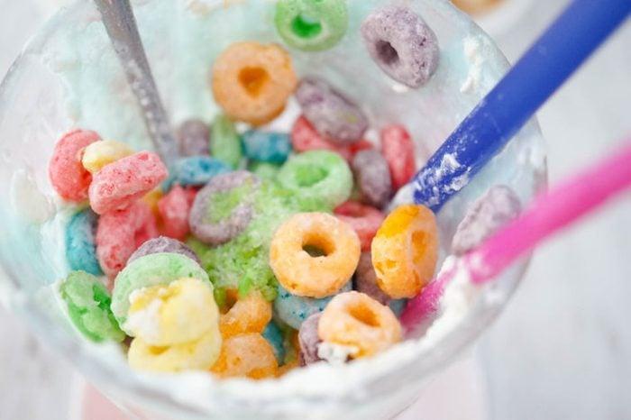 Colorful cereals left in glass, leftover food. Soft focus