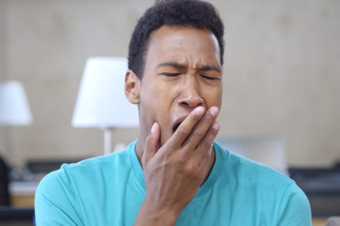 Sleepy Yawing Afro-American Man in Office, Portrait