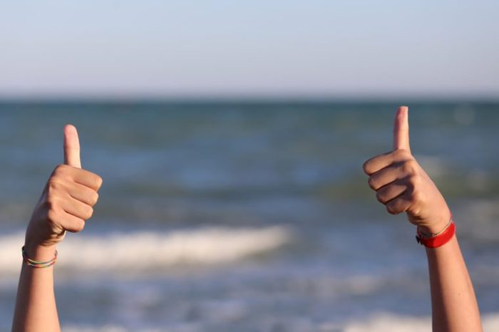 Two hands with thumbs up in ok sign
