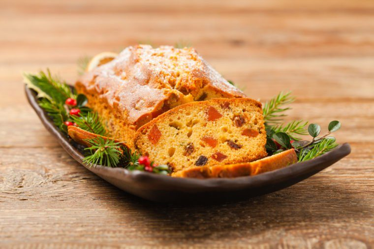 Christmas cake. Fruitcake. Natural wooden background. Top view.