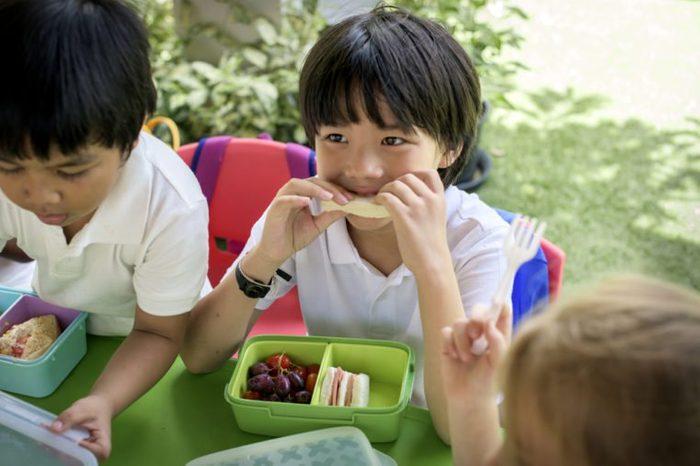 Group of Kindergarten Students Eating Food Lunch Break Together