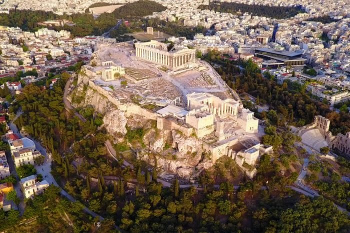 Aerial birds eye view photo taken by drone of iconic Acropolis hill and the Parthenon, Athens historic center, Attica, Greece