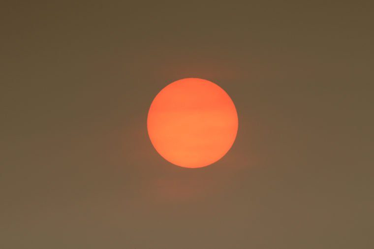The Sun colour in the Uk was due to a weather phenomenon, Saharan dust, blown in by ex-hurricane Ophelia and also from debris, caused by fires in Portugal and Spain.