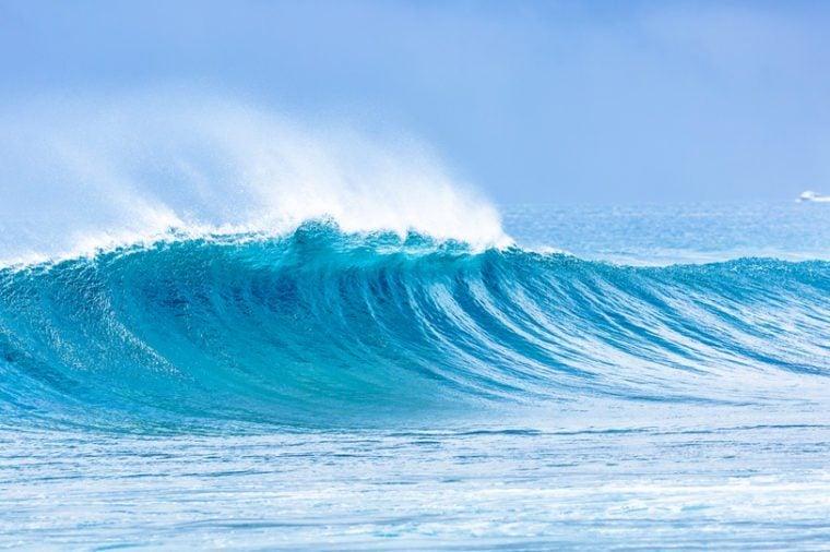 Beautiful panorama of splashing blue wave curl.