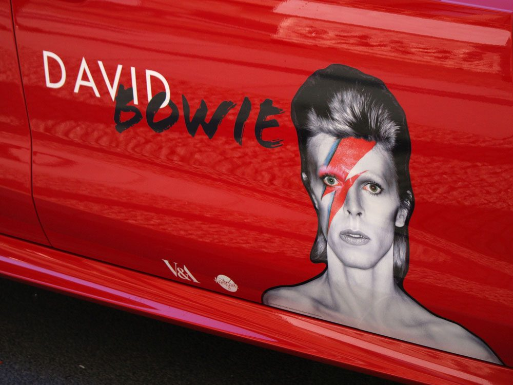 David Bowie on car