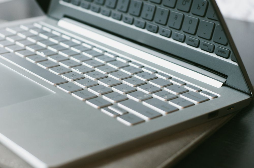 Open laptop on the table. Computer keyboard close-up