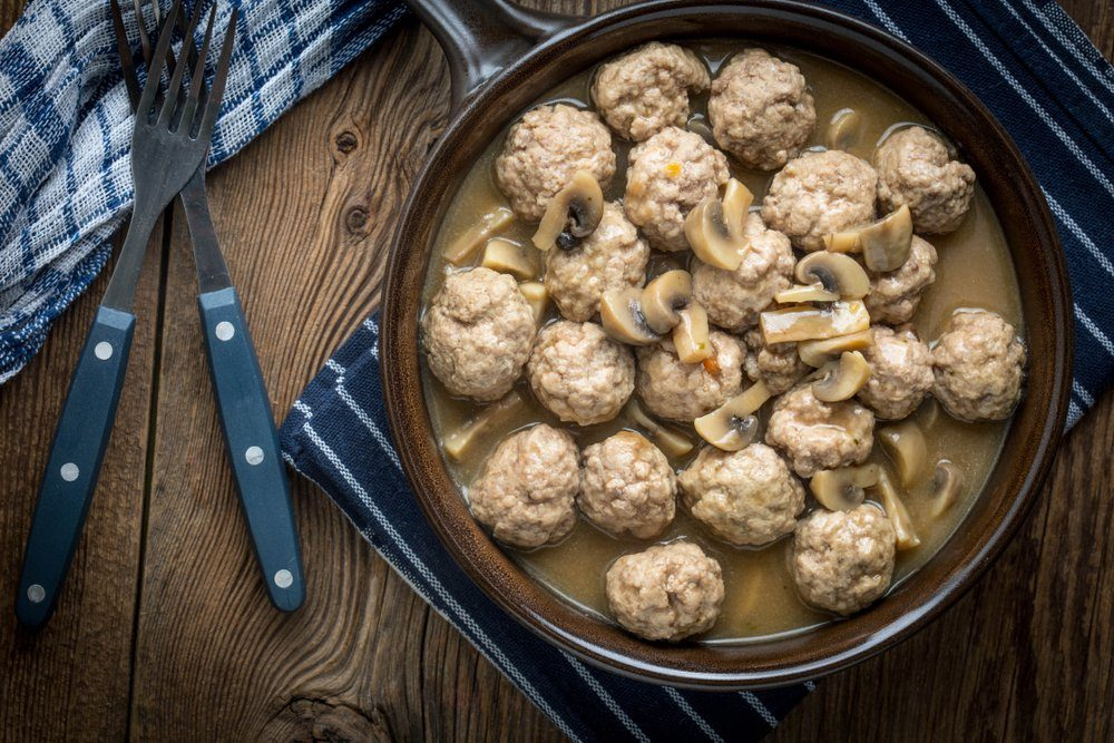 Delicious homemade swedish meatballs with mushroom cream sauce. Small depth of field. Top view.