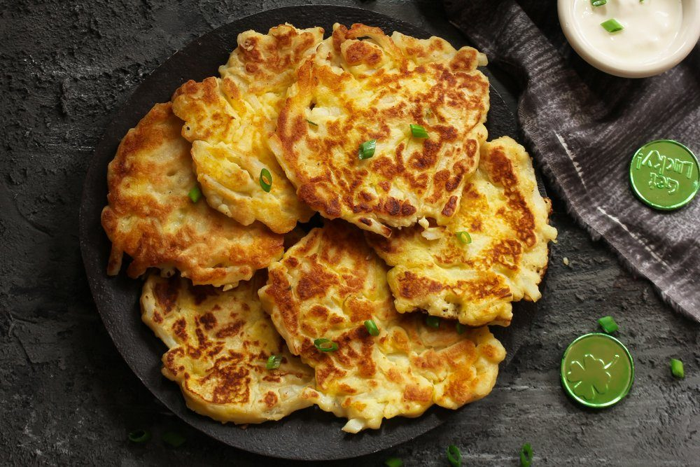 Homemade Irish Potato Pancakes (Boxty) / St.Patrick day food / Latkes served with sour cream dip top view