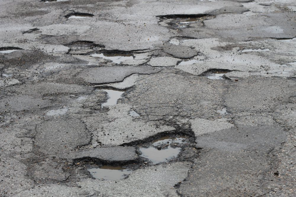 deep potholes in the road make driving hazardous